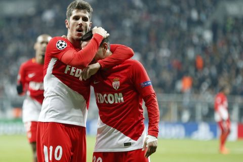 Monaco's Marcos Lopes, right, celebrates with Stevan Jovetic after scoring his side's opening goal during the Champions League group G soccer match between Besiktas and Monaco at the Besiktas Park stadium in Istanbul, Wednesday, Nov. 1, 2017. (AP Photo/Lefteris Pitarakis)