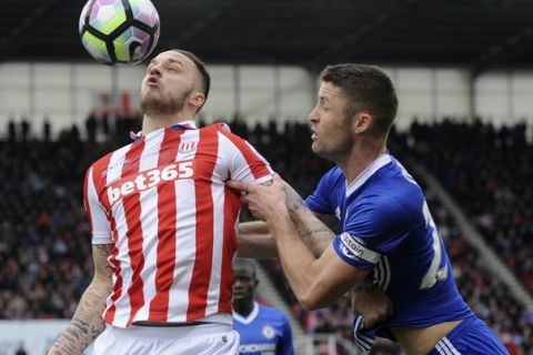 Stoke's Marko Arnautovic, left, and Chelsea's Gary Cahill battle for the ball during the English Premier League soccer match between Stoke City and Chelsea at the Britannia Stadium, Stoke on Trent, England, Saturday, March 18, 2017. (AP Photo/Rui Vieira)