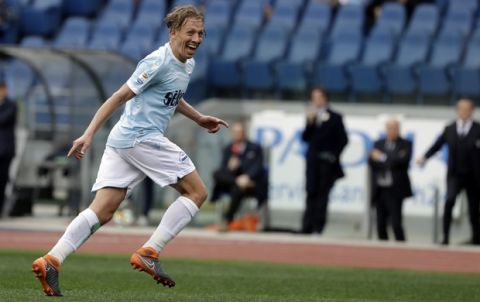 Lazio's Lucas Leiva celebrates after scoring during a Serie A soccer match between Lazio and Benevento, at Rome's Olympic Stadium, Saturday, March 31, 2018. (AP Photo/Andrew Medichini)
