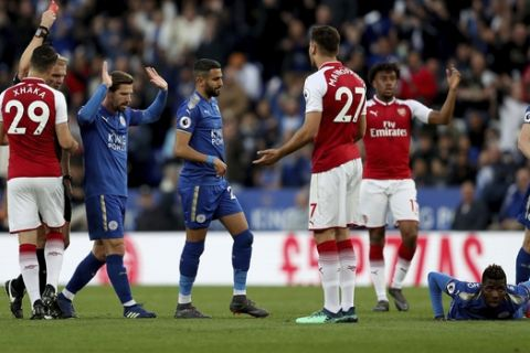 Arsenal's Konstantinos Mavropanos, no. 27, is sent off by match referee Graham Scott during the English Premier League soccer match against Leicester City at the King Power Stadium, Leicester, England, Wednesday May 9, 2018. (David Davies/PA via AP)
