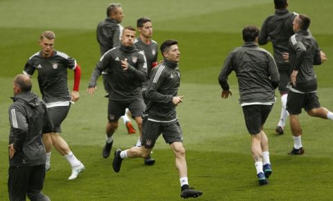 Bayern Munich players warm up during a training session at the Santiago Bernabeu stadium in Madrid, Monday, April 30, 2018. Bayern Munich will play a Champions League semifinal second leg soccer match against Real Madrid on Tuesday May 1. (AP Photo/Francisco Seco)