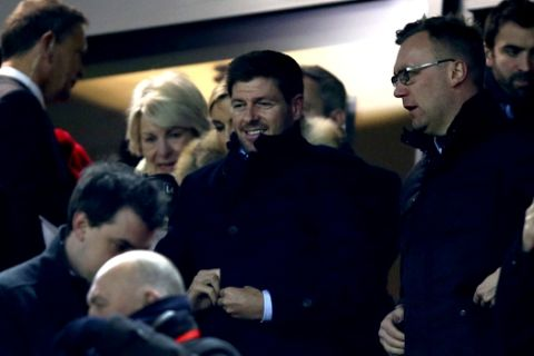 Former Liverpool captain Steven Gerrard, center, takes his seat before the English League Cup semifinal 2nd leg soccer match between Liverpool and Southampton at Anfield stadium in Liverpool, England, Wednesday, Jan. 25, 2017. (AP Photo/Dave Thompson)