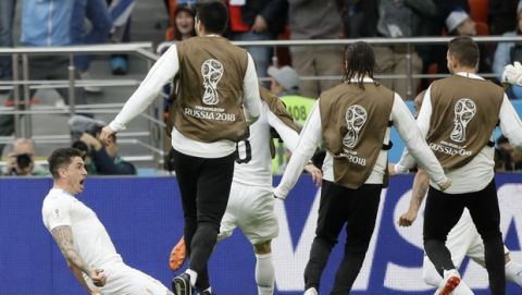 Uruguay's Jose Gimenez, left, celebrates after scoring his side's opening goal during the group A match between Egypt and Uruguay at the 2018 soccer World Cup in the Yekaterinburg Arena in Yekaterinburg, Russia, Friday, June 15, 2018. (AP Photo/Mark Baker)