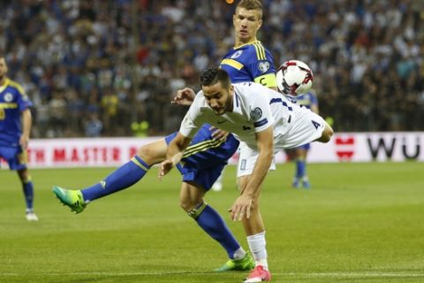 Bosnia's Edin Dzeko, right, and Greece's Kostas Manolas, fight for the ball during their World Cup Group H qualifying match at the Bilino Polje Stadium in Zenica on Friday, June 9, 2017. (AP Photo/Amel Emric)
