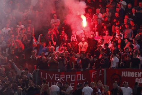 Liverpool fans light flares prior to the start of the Champions League semifinal second leg soccer match between Roma and Liverpool at the Olympic Stadium in Rome, Wednesday, May 2, 2018. (AP Photo/Riccardo De Luca)