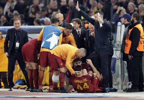 Roma's Kostas Manolas, bottom, celebrates after scoring his side's 3rd goal during the Champions League quarterfinal second leg soccer match between Roma and FC Barcelona at Rome's Olympic Stadium, Tuesday, April 10, 2018. (AP Photo/Andrew Medichini)