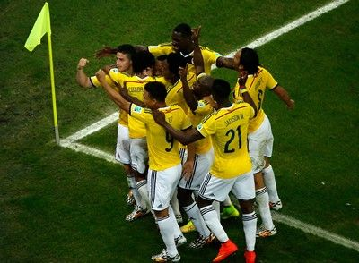 RIO DE JANEIRO, BRAZIL - JUNE 28:  James Rodriguez of Colombia celebrates scoring his team's second goal and his second of the game with teammates during the 2014 FIFA World Cup Brazil round of 16 match between Colombia and Uruguay at Maracana on June 28, 2014 in Rio de Janeiro, Brazil.  (Photo by Pool/Getty Images)
