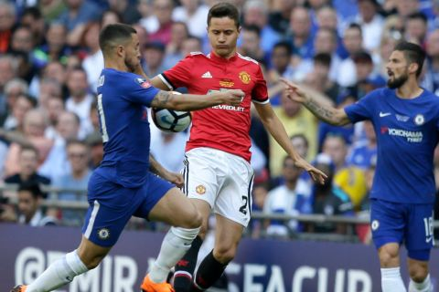 Chelsea's Eden Hazard, left, vies for the ball with Manchester United's Ander Herrera during the English FA Cup final soccer match between Chelsea and Manchester United at Wembley stadium in London, Saturday, May 19, 2018. (AP Photo/Tim Ireland)