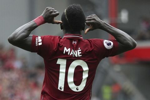 Liverpool's Sadio Mane celebrates scoring his side's second goal of the game during the Premier League soccer match between Liverpool and West Ham United at Anfield, Liverpool, England. Sunday Aug. 12, 2018. (David Davies/PA via AP)