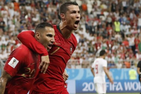 Portugal's Ricardo Quaresma, left, celebrates scoring his team's opening goal along with teammate Portugal's Cristiano Ronaldo during the group B match between Iran and Portugal at the 2018 soccer World Cup at the Mordovia Arena in Saransk, Russia, Monday, June 25, 2018. (AP Photo/Pavel Golovkin)