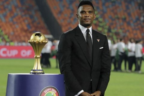 Cameroon's soccer star Samuel Eto'o display the trophy before the African Cup of Nations final soccer match between Algeria and Senegal in Cairo International stadium in Cairo, Egypt, Friday, July 19, 2019. (AP Photo/Hassan Ammar)