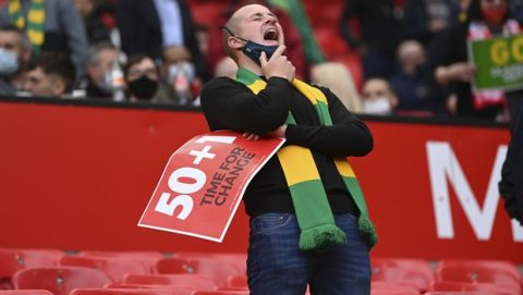 Manchester United fan is seen before the English Premier League soccer match between Manchester United and Fulham at Old Trafford stadium in Manchester, England, Tuesday, May 18, 2021. (AP Photo/Laurence Griffiths, Pool)