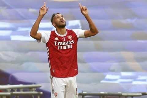 Arsenal's Pierre-Emerick Aubameyang celebrates after scoring his side's second goal during the FA Cup final soccer match between Arsenal and Chelsea at Wembley stadium in London, England, Saturday, Aug.1, 2020. (Catherine Ivill/Pool via AP)