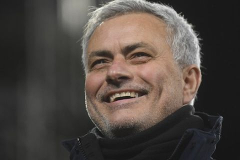 FILE - In this Thursday, March 4, 2021 file photo, Tottenham's manager Jose Mourinho smiles during the English Premier League soccer match between Fulham v Tottenham Hotspur at the Craven Cottage stadium in London. José Mourinho has been hired to coach Italian club Roma starting next season. The move came a few hours after the clubs American owners announced that current coach Paulo Fonseca will depart at the end of this season. Mourinhos contract is for three seasons. Mourinho previously coached in Serie A at Inter Milan. (Neil Hall/Pool via AP, File)