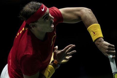 Spain's Rafael Nadal serves to Russia's Karen Khachanov during their Davis Cup tennis match in Madrid, Spain, Tuesday, Nov. 19, 2019. (AP Photo/Bernat Armangue)