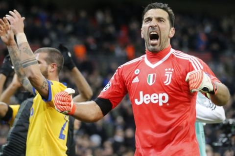Juventus goalkeeper Gianluigi Buffon celebrates at the end of a the Champions League, round of 16, second-leg soccer match between Juventus and Tottenham Hotspur, at the Wembley Stadium in London, Wednesday, March 7, 2018. Juventus won 2-1. (AP Photo/Frank Augstein)