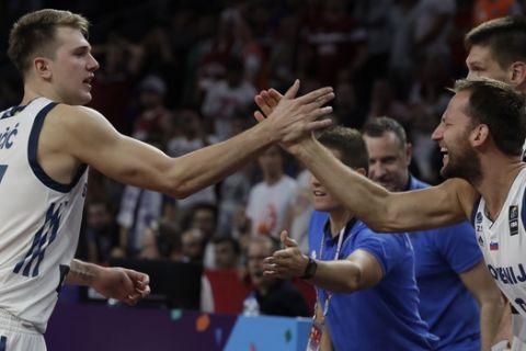 Slovenia's Luka Doncic, left, celebrates with teammates during their Eurobasket European Basketball Championship quarterfinal match against Latvia, in Istanbul, Tuesday, Sept. 12. 2017. (AP Photo/Thanassis Stavrakis)