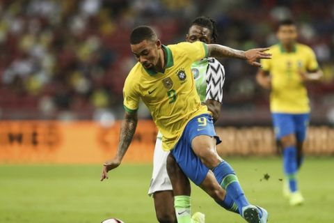Brazil's Gabriel Jesus goes for the ball during the international friendly match between Brazil and Nigeria in Singapore, Sunday, Oct. 13, 2019. (AP Photo/Danial Hakim)
