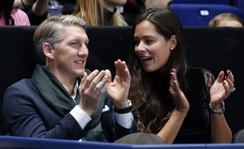 German footballer Bastian Schweinsteiger and wife Ana Ivanovic applaud during the ATP World Tour Finals singles final tennis match between Andy Murray of Britain and Novak Djokovic of Serbia at the O2 Arena in London, Sunday, Nov. 20, 2016. (AP Photo/Alastair Grant)