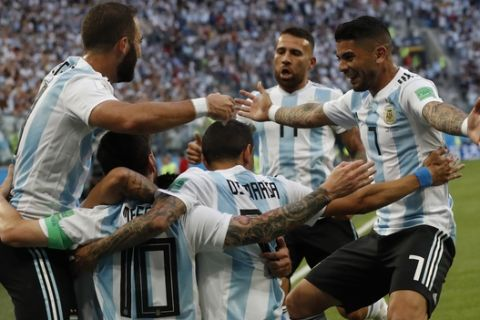 Argentina's Lionel Messi celebrates with his teammates after scoring the opening goal of his team during the group D match between Argentina and Nigeria, at the 2018 soccer World Cup in the St. Petersburg Stadium in St. Petersburg, Russia, Tuesday, June 26, 2018. (AP Photo/Petr David Josek)