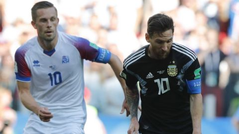 Argentina's Lionel Messi, right, challenges for the ball with Iceland's Gylfi Sigurdsson during the group D match between Argentina and Iceland at the 2018 soccer World Cup in the Spartak Stadium in Moscow, Russia, Saturday, June 16, 2018. (AP Photo/Ricardo Mazalan)