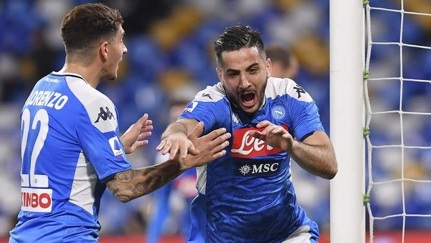 Napoli's Konstantinos Manolas, right, celebrates after scoring during a Serie A soccer match between Napoli and Torino at the San Paolo Stadium in Naples, Italy, Saturday, Feb. 29, 2020. (Cafaro/LaPresse via AP)