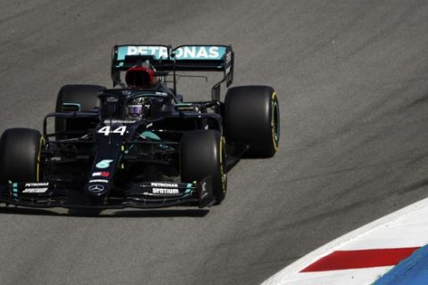 Mercedes driver Lewis Hamilton of Britain steers his car during the Formula One Grand Prix at the Barcelona Catalunya racetrack in Montmelo, Spain, Sunday, Aug. 16, 2020. (Bryn Lennon, Pool via AP)