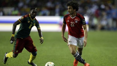 Egypt's Amr Warda, right, controls the ball in front of Cameroon's Ambroise Oyongo during the African Cup of Nations final soccer match between Egypt and Cameroon at the Stade de l'Amitie, in Libreville, Gabon, Sunday, Feb. 5, 2017. (AP Photo/Sunday Alamba)