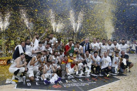 Real Madrid players celebrate as they win the Final Four Euroleague final basketball match between Real Madrid and Fenerbahce Istanbul in Belgrade, Serbia, Sunday, May 20, 2018. (AP Photo/Darko Vojinovic)