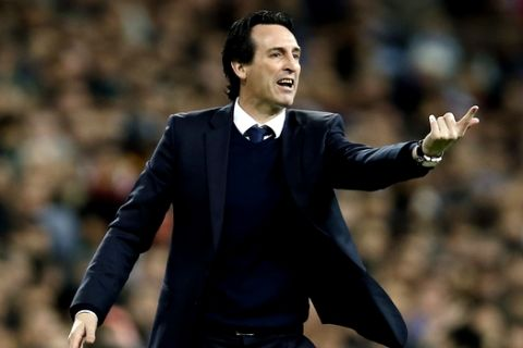 PSG head coach Unai Emery reacts on the sidelines during a Champions League Round of 16 first leg soccer match between Real Madrid and Paris Saint Germain at the Santiago Bernabeu stadium in Madrid, Spain, Wednesday, Feb. 14, 2018. (AP Photo/Francisco Seco)