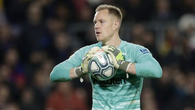 "Barcelona's goalkeeper Marc-Andre ter Stegen holds the ball during a Spanish La Liga soccer match between Barcelona and Real Madrid at Camp Nou stadium in Barcelona, Spain, Wednesday, Dec. 18, 2019. Thousands of Catalan separatists are planning to protest around and inside Barcelona's Camp Nou Stadium during Wednesday's ""Clasico"". (AP Photo/Bernat Armangue)"