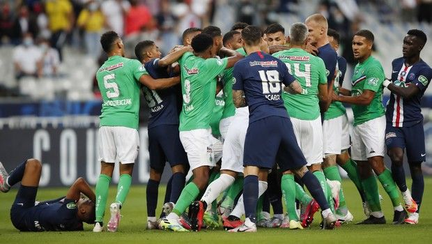 Players scrum after PSG's Kylian Mbappe, left down, was tackled during the French Cup soccer final match between Paris Saint Germain and Saint Etienne at Stade de France stadium, in Saint Denis, north of Paris, Friday July 24, 2020. (AP Photo/Francois Mori)