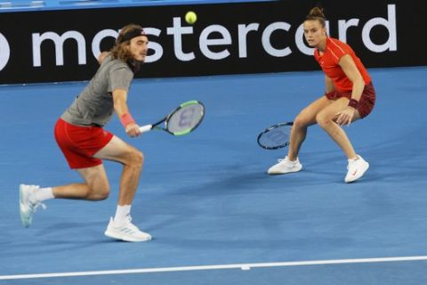 Stefanos Tsitsipas and Maria Sakkari of Greece during their mixed doubles match against Switzerland's Roger Federer and Belinda Bencic at the Hopman Cup in Perth, Australia, Thursday Jan. 3, 2019. (AP Photo/Trevor Collens)