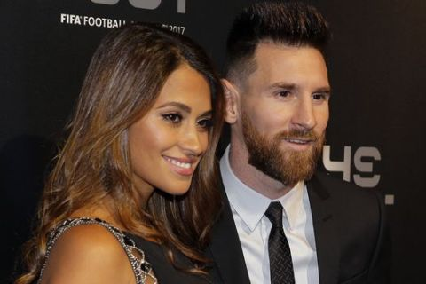 FILE - In this Monday, Oct. 23, 2017 file photo, Soccer player Lionel Messi and wife Antonella arrive to attend The Best FIFA 2017 Awards at the Palladium Theatre in London. Cristiano Ronaldo and Lionel Messi put up impressive numbers, in life and on the field, going into a fourth World Cup for each. So much has happened for football's standout stars since the 2014 tournament left both still lacking the game's most coveted prize. (AP Photo/Alastair Grant, File)