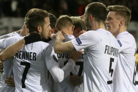 LASK's players celebrate after scoring their side's opening goal during the Europa League round of 32, second leg, soccer match between LASK and AZ Alkmaar at the Linz Stadium in Linz, Austria, Thursday, Feb. 27, 2020. (AP Photo/Ronald Zak)