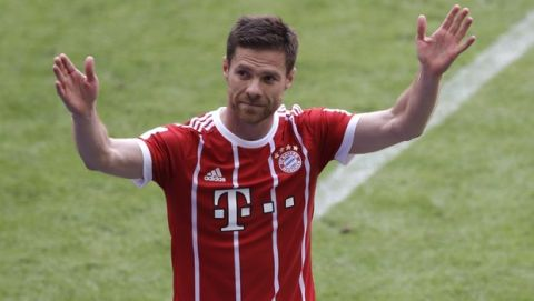 Bayern's Xabi Alonso waves to supporters as he leaves the field during the German first division Bundesliga soccer match between FC Bayern Munich and SC Freiburg at the Allianz Arena stadium in Munich, Germany, Saturday, May 20, 2017. (AP Photo/Matthias Schrader)