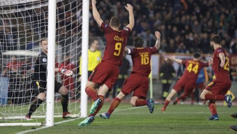 Roma players celebrate with teammate Kostas Manolas, second right, after he scored his side's third goal during the Champions League quarterfinal second leg soccer match between between Roma and FC Barcelona, at Rome's Olympic Stadium, Tuesday, April 10, 2018. (AP Photo/Gregorio Borgia)