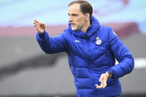 Chelsea's head coach Thomas Tuchel gives instructions from the side line during the English Premier League soccer match between West Ham United and Chelsea at London Stadium, London, England, Saturday, April 24, 2021. (Andy Rain/Pool via AP)