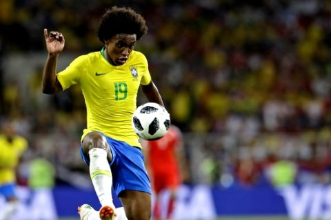 Brazil's Willian kicks the ball during the group E match between Serbia and Brazil, at the 2018 soccer World Cup in the Spartak Stadium in Moscow, Russia, Wednesday, June 27, 2018. (AP Photo/Andre Penner)