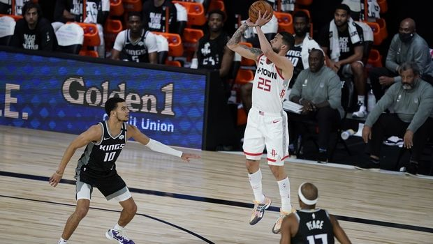 Houston Rockets' Austin Rivers (25) shoots over Sacramento Kings' Justin James (10) during the second half of an NBA basketball game Sunday, Aug. 9, 2020, in Lake Buena Vista, Fla. The Rockets won 129-112. (AP Photo/Ashley Landis, Pool)