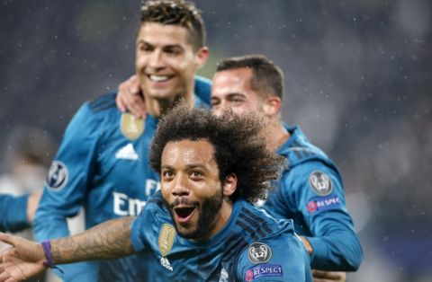 Real Madrid's Marcelo, front,celebrates after scoring his side's third goal during the Champions League first leg quarter final soccer match between Juventus and Real Madrid, at Juventus Stadium in Turin, Italy, Tuesday, April 3, 2018. (AP Photo/Antonio Calanni)