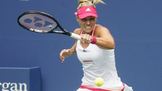 Angelique Kerber, of Germany, returns a shot to Ajla Tomljanovic, of Australia, during the first round of the US Open tennis championships, Monday, Aug. 31, 2020, in New York. (AP Photo/Frank Franklin II)