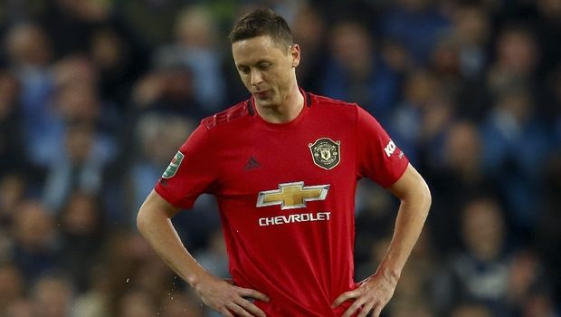 Manchester United's Nemanja Matic reacts after being shown a second yellow card during the English League Cup semifinal second leg soccer match between Manchester City and Manchester United at Etihad stadium in Manchester, England, Wednesday, Jan. 29, 2020. (AP Photo/Dave Thompson)