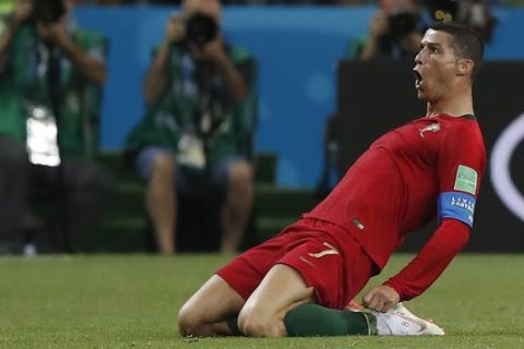 Portugal's Cristiano Ronaldo celebrates after scoring his sides 2nd goal of the game during the group B match between Portugal and Spain at the 2018 soccer World Cup in the Fisht Stadium in Sochi, Russia, Friday, June 15, 2018. (AP Photo/Manu Fernandez)