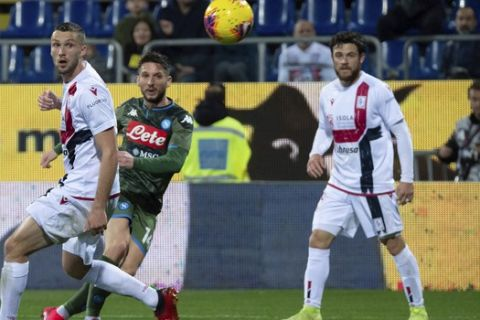 Napoli's Dries Mertens, center, eyes the ball as he scores during a Serie A soccer match between Cagliari and Napoli, in Cagliari's Sardegna Arena, on the island of Sardinia, Italy, Sunday, Feb. 16, 2020.  (Alessandro Tocco/LaPresse via AP)