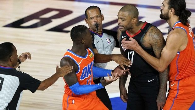 Houston Rockets' P.J. Tucker, center right, is held back by Oklahoma City Thunder's Steven Adams, right, as he confronts Dennis Schroder, center left, while officials step in during the second half of an NBA basketball first round playoff game Saturday, Aug. 29, 2020, in Lake Buena Vista, Fla. Both players were ejected. Both Schroder and Tucker were ejected from the game. (AP Photo/Ashley Landis)