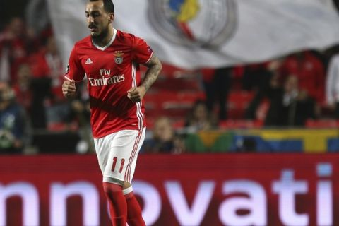 Benfica's Kostas Mitroglou walks after scoring the opening goal during the Champions League round of 16, first leg, soccer match between Benfica and Borussia Dortmund at the Luz stadium in Lisbon, Tuesday, Feb. 14, 2017. (AP Photo/Armando Franca)