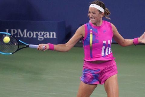 Victoria Azarenka, of Belarus, returns a shot to Anastasija Sevastova, of Latvia, during the third round of the U.S. Open tennis championships, Thursday, Sept. 3, 2020, in New York. (AP Photo/Frank Franklin II)