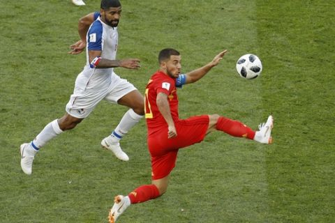 Belgium's Eden Hazard, right, lunges for the ball against Panama's Gabriel Gomez during the group G match between Belgium and Panama at the 2018 soccer World Cup in the Fisht Stadium in Sochi, Russia, Monday, June 18, 2018. (AP Photo/Victor R. Caivano)
