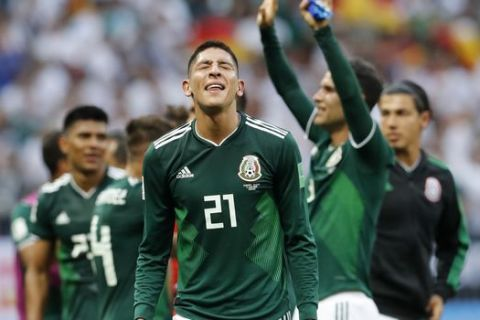 Mexico players celebrate after winning the group F match between Germany and Mexico at the 2018 soccer World Cup in the Luzhniki Stadium in Moscow, Russia, Sunday, June 17, 2018. Mexico won Germany 1-0. (AP Photo/Antonio Calanni)